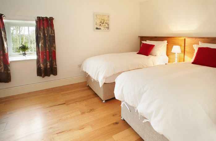 Ground floor:  Twin bedroom with 3' zip and link beds (can be converted to a double on request)