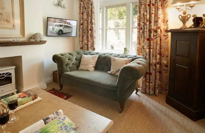 Ground floor: Sitting room with electric fire