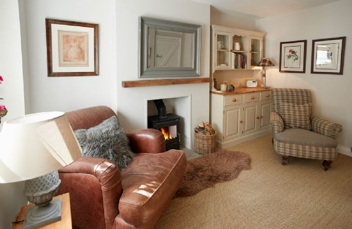 Ground floor: Dining/sitting room with wood burning stove