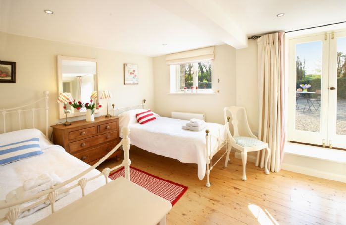 Ground floor: Twin bedroom with 3' beds and en-suite shower room