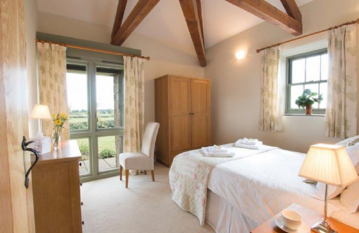 Ground floor: Double bedroom with a 5' bed and feature beams