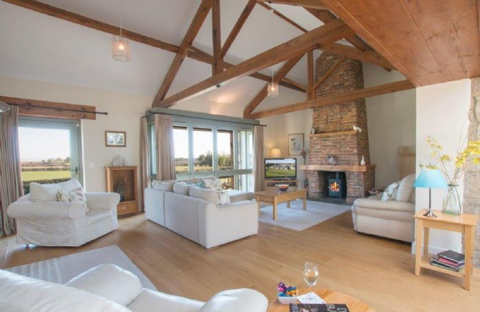 Ground floor:  Spacious open plan sitting room with wood burning stove
