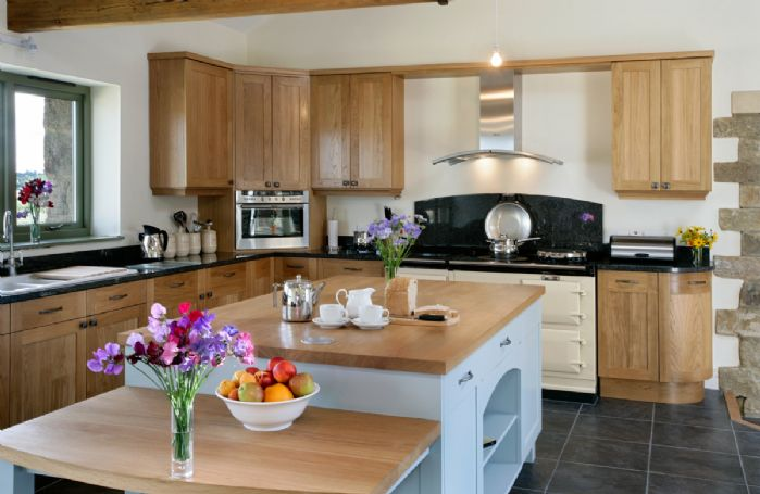 Ground floor:  Large kitchen with a four oven cream Aga