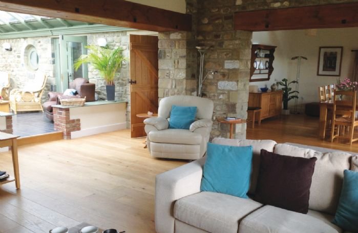 Ground floor:  Open plan sitting room with adjoining conservatory