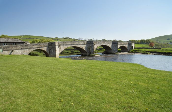 The 16th century stone bridge straddling the River Wharfe