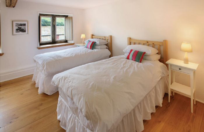 First floor:  One of two twin bedrooms with two 3' beds which can be joined together to make a 6' bed upon request