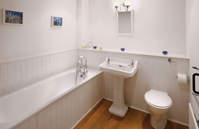 First floor:  En-suite bathroom with hand held shower