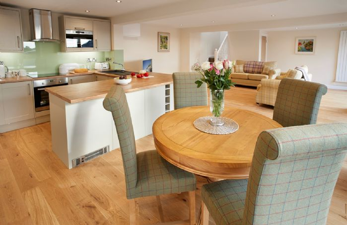 Ground floor: Spacious kitchen with dining table and chairs