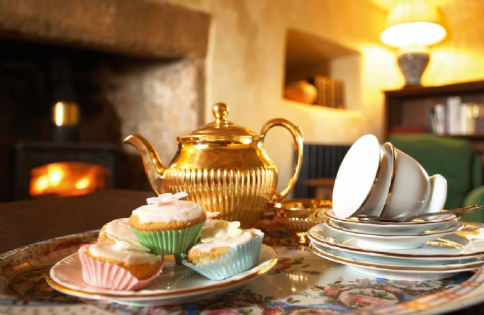 Tea and cake in front of the wood burning stove