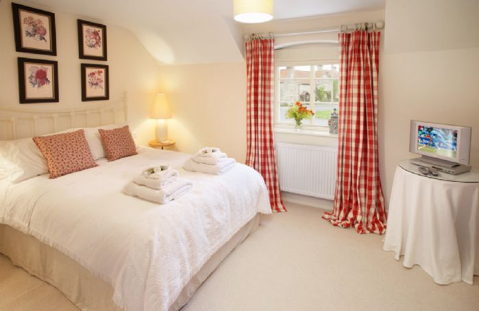 First floor: Double bedroom with 5' bed and en-suite bathroom