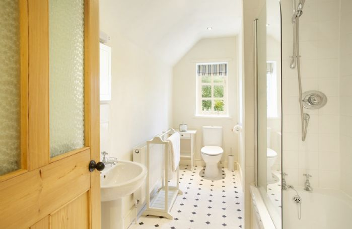 First floor: Bathroom with bath and shower over