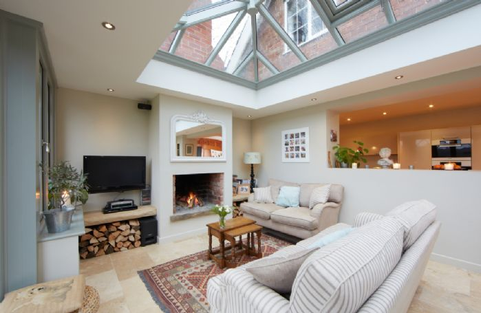 Ground floor: David Salisbury orangery with dining and seating, underfloor heating and an open fire