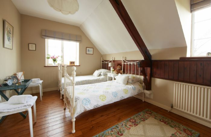 First floor:  Twin bedroom with two 3' beds
