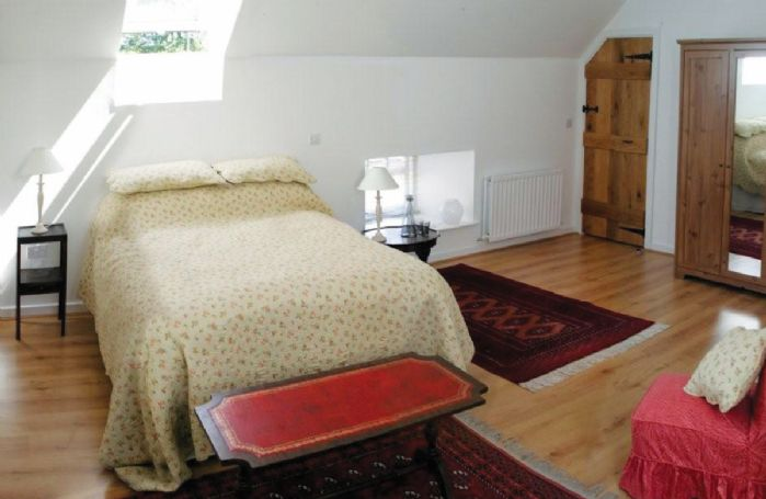 First floor:  Spacious double bedroom with en-suite shower room