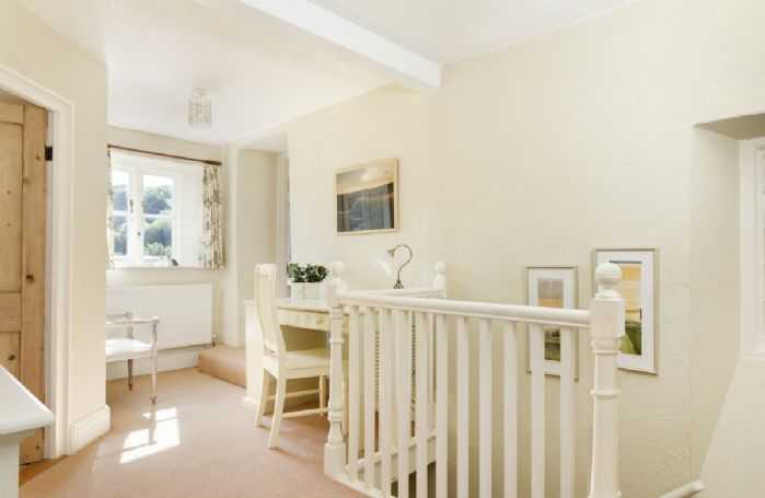 First Floor: Internal stairs take you to the first floor to a sun drenched landing with writing desk