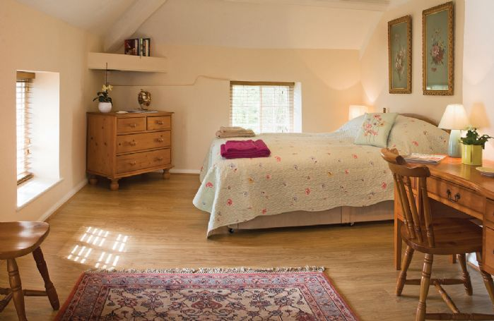 First floor:  Spacious double bedroom with king size bed