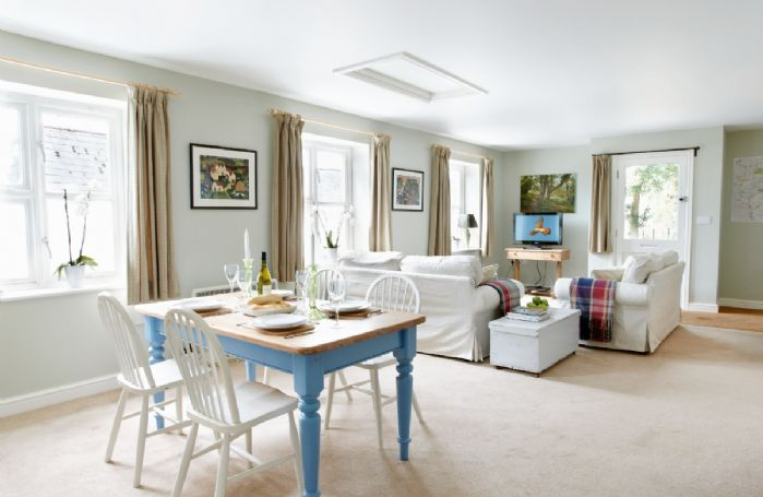 Ground floor:  Open plan dining and sitting room with kitchen behind