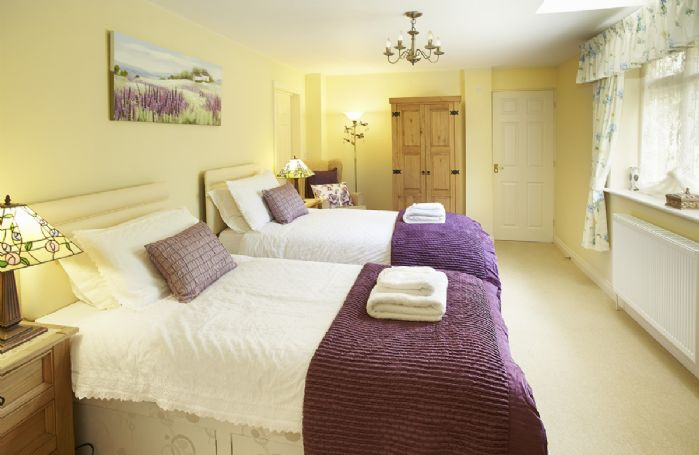 Ground floor: Twin bedroom with 3' beds with fully tiled wet room with shower and wc
