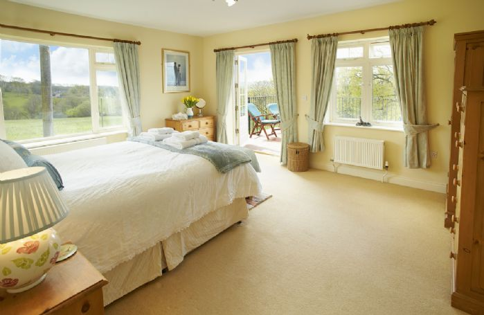 First floor: Second large master bedroom with 5' bed and patio doors leading onto the balcony