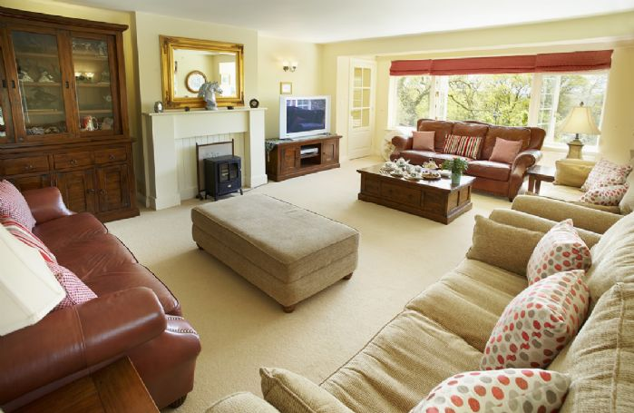 Ground floor: Large 26ft drawing room with comfy sofas for twelve guests