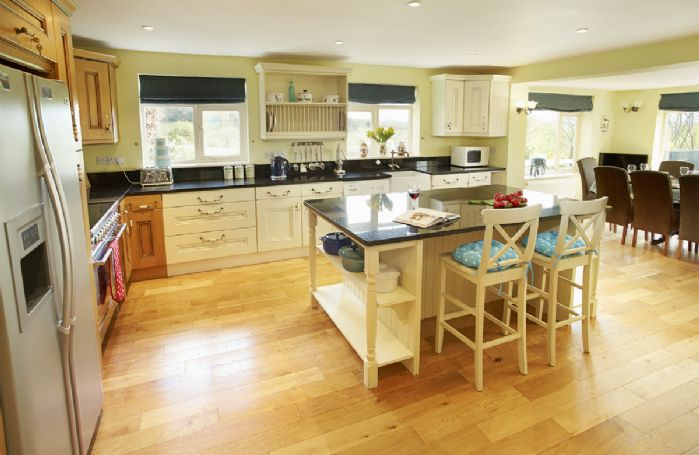Ground floor: Stunning 40ft farmhouse kitchen/dining room with seating for twelve guests with spectacular views over the meadow
