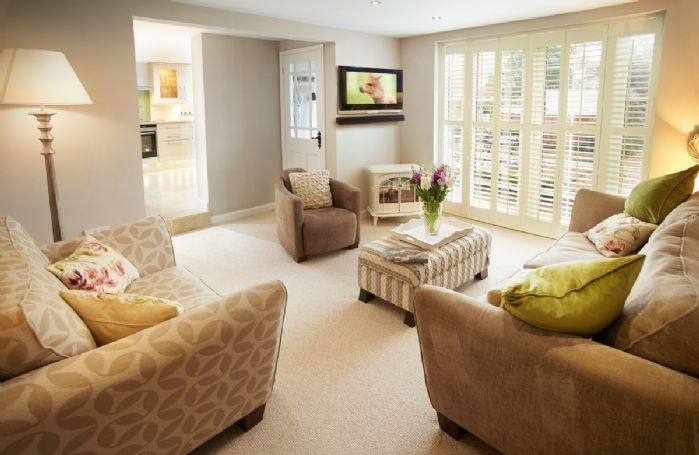 Ground floor: Sitting room with double doors opening onto the terrace