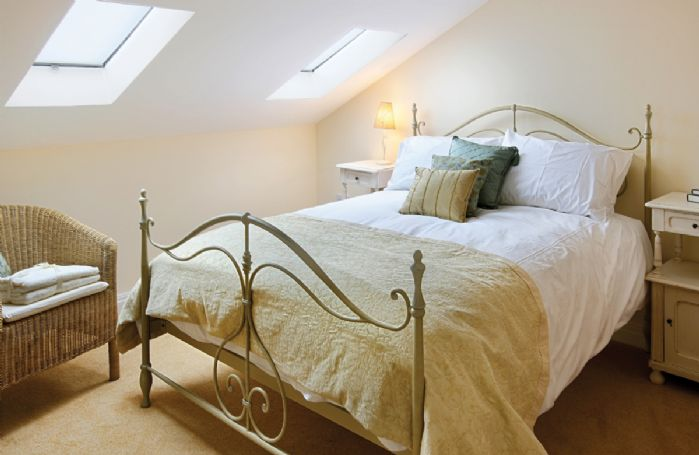 Damson Cottage:  First floor: Master bedroom with 5' bed and fully tiled en suite shower room with wc and basin