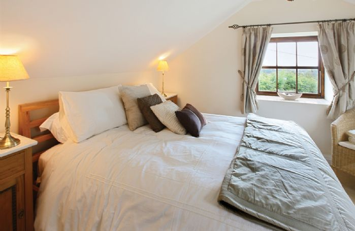 Orchard Cottage:  First floor: Master bedroom with 5' bed and en-suite fully tiled shower room, wc and basin