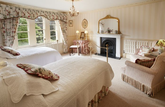 Second floor:  large bedroom with lovely views over the front lawns through triple arched windows