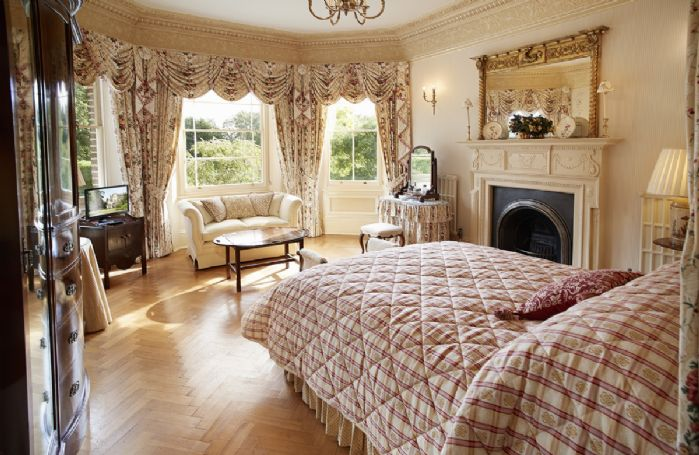 First floor: Large bedroom with 5' double bed, Edwardian marquetry triple wardrobe and Regency sofa.