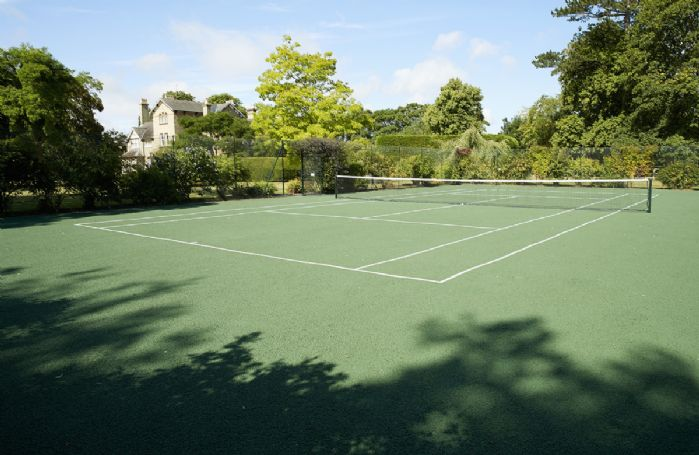 Full size tarmac tennis court, recently re-painted with anti-slip finish. Rackets and balls provided