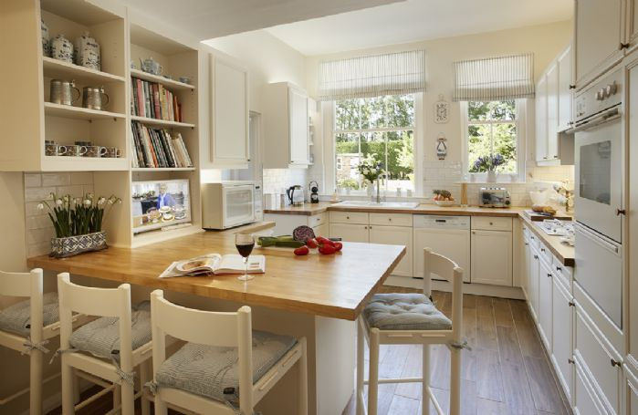 Ground floor: Homely country kitchen with breakfast bar