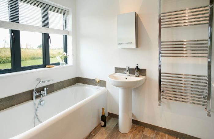 Ground floor: Bathroom containing bath with hand held spray attachment and separate electric power shower