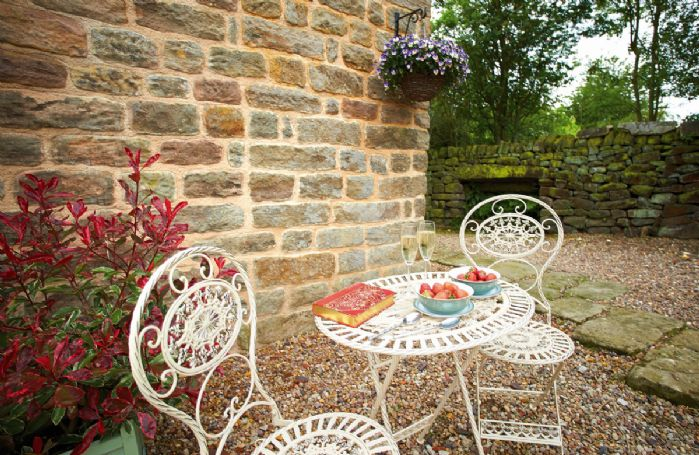 Patio area with garden table and chairs