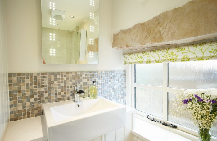 First floor: En-suite bathroom with shower over