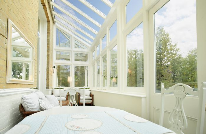 Ground floor: Conservatory adjoining the sitting room overlooking the sea