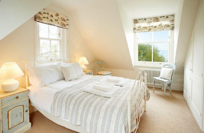 Second floor: West wing double bedroom with 4'6 bed