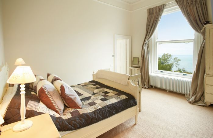 First floor: Master bedroom with 5' bed with en-suite bathroom with separate shower