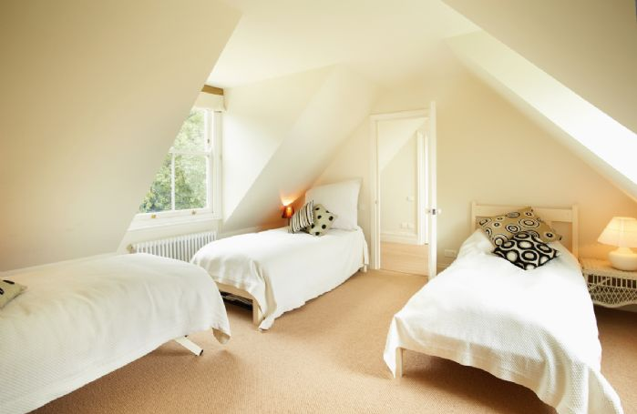 Second Floor: West wing large bedroom with three 3' single beds