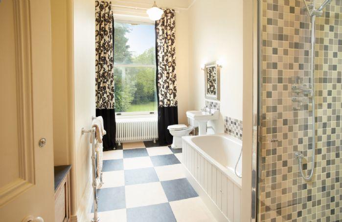 First floor: En-suite bathroom to single bedroom