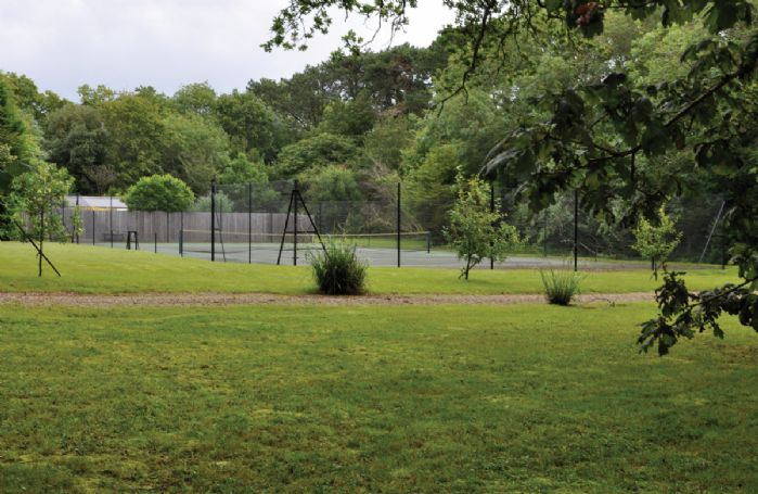 The extensive grounds also include an asphalt tennis court