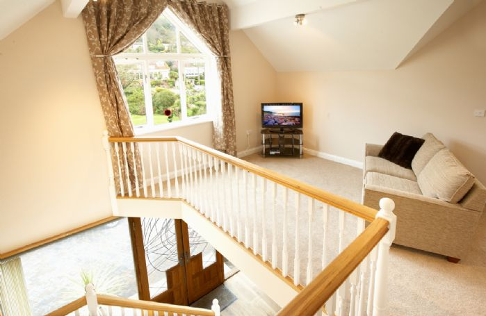 First Floor: Large gallery landing with settee and separate TV with Xbox 360