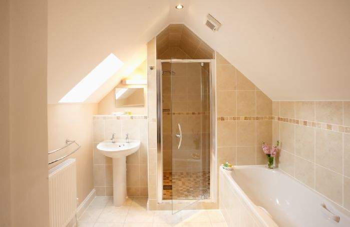First floor:  En-suite bathroom with separate shower