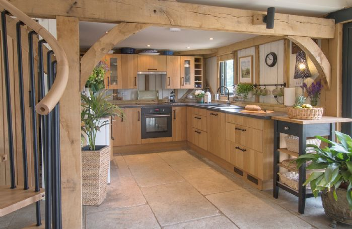 Ground floor: Open plan kitchen.  Spiral staircase (please note the upstairs accommodation is not available to guests)