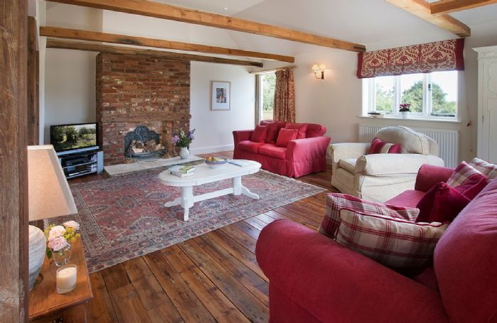 Ground floor:  Large, beamed sitting room with stable doors onto the garden