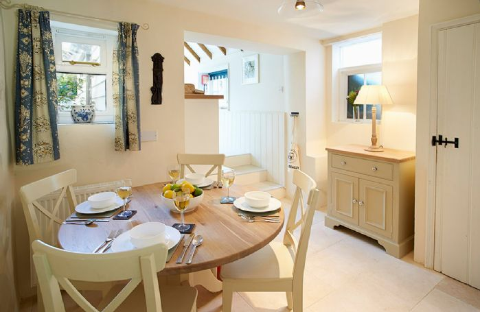 Ground floor: Dining area with 2 steps up to kitchen and french doors to rear garden