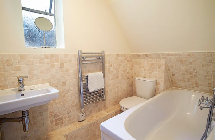 Ground floor: Bathroom with bath, hand-held shower attachment and wc