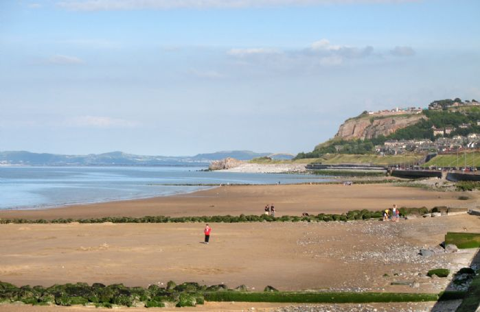 Llandudno has a sheltered beach with a long Victorian pier and wide promenade
