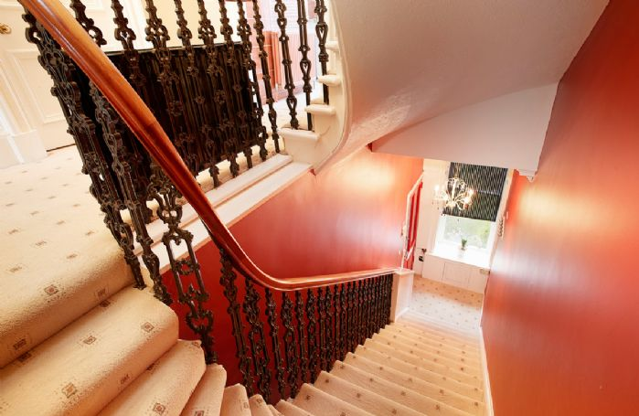 Classic Georgian style staircase leading to the second floor