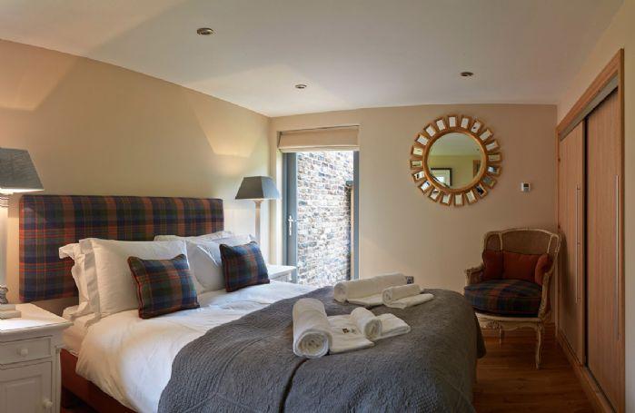 Ground floor: Double bedroom with walk in wardrobe